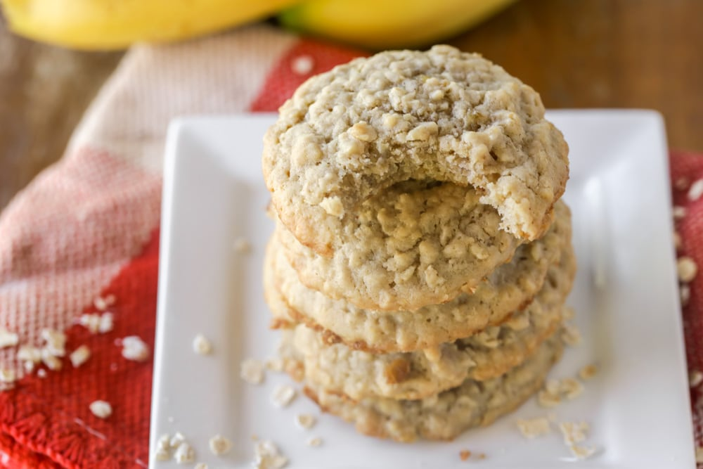 A stack of banana oatmeal cookies on a white plate