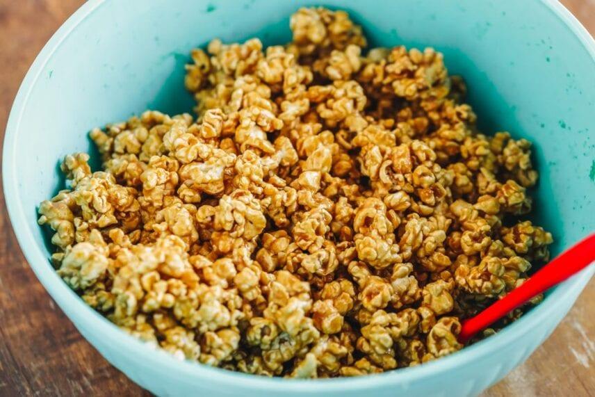 Mixing caramel corn recipe in bowl