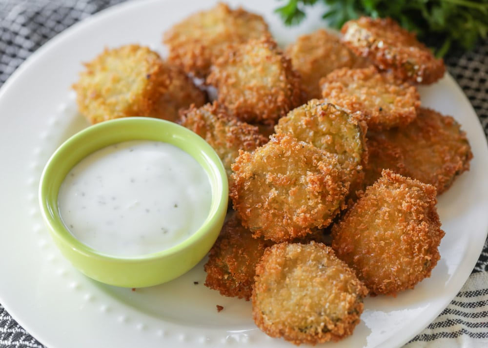 Deep Fried Pickles on a platter with ranch dipping sauce