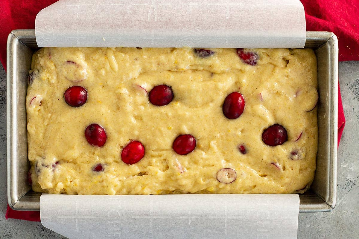 Moist cranberry orange bread ready to be baked