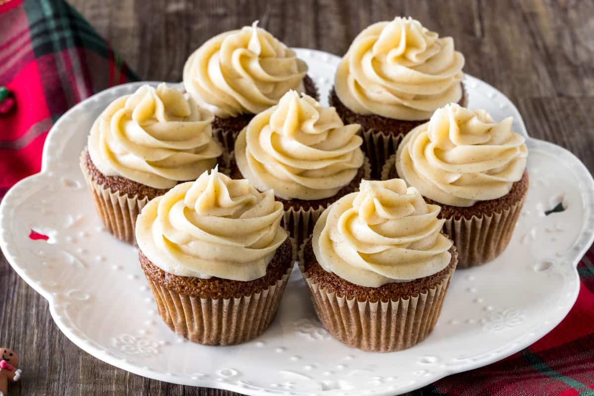 A plate of gingerbread cupcakes with cinnamon cream cheese frosting