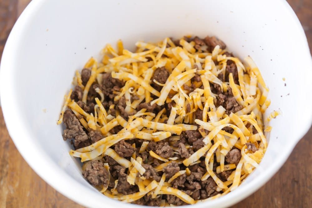 Hamburger meat and cheese in bowl for tacos