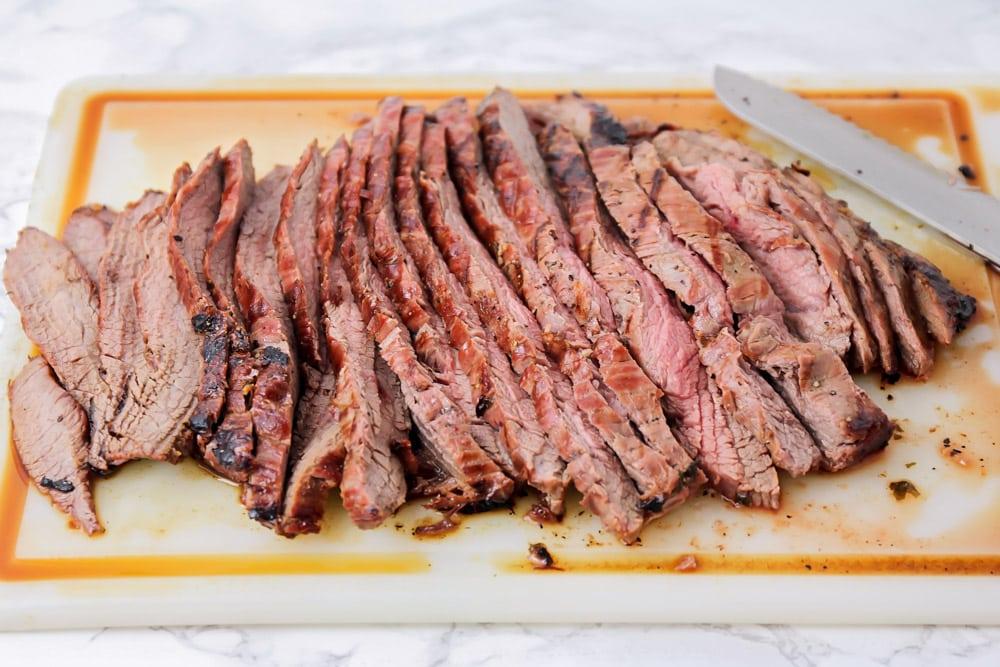 Sliced carne asada on a cutting board