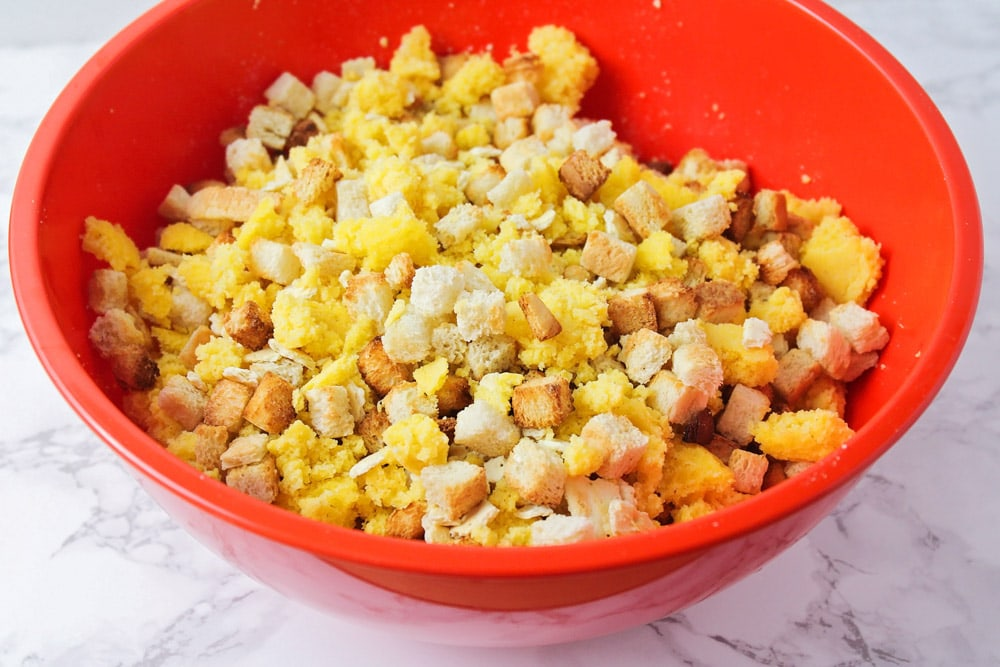 Cornbread stuffing ingredients in a mixing bowl