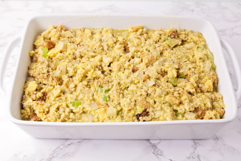 Stuffing mixture in a casserole dish before baking