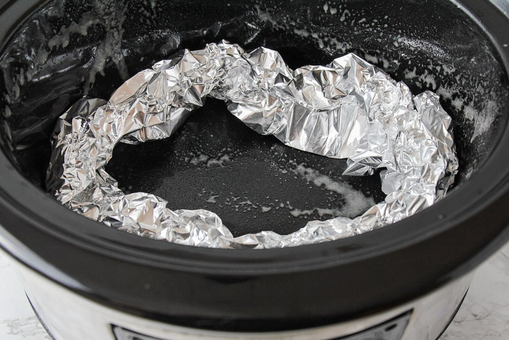Tinfoil ring inside the crockpot for roasting the chicken