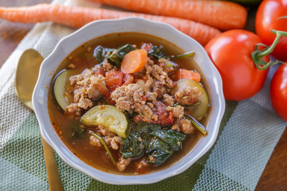 Italian sausage soup in gray bowl