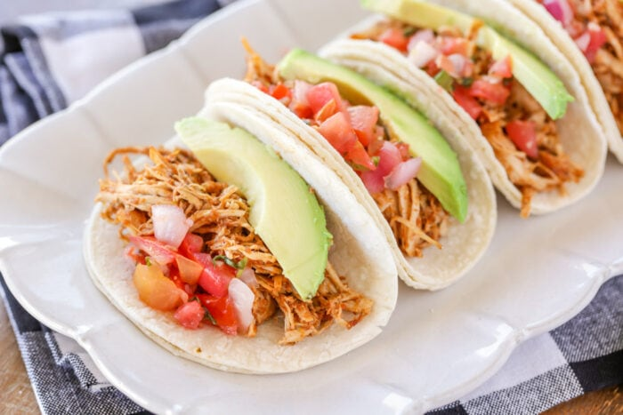 Slow cooker chicken tacos on a white platter