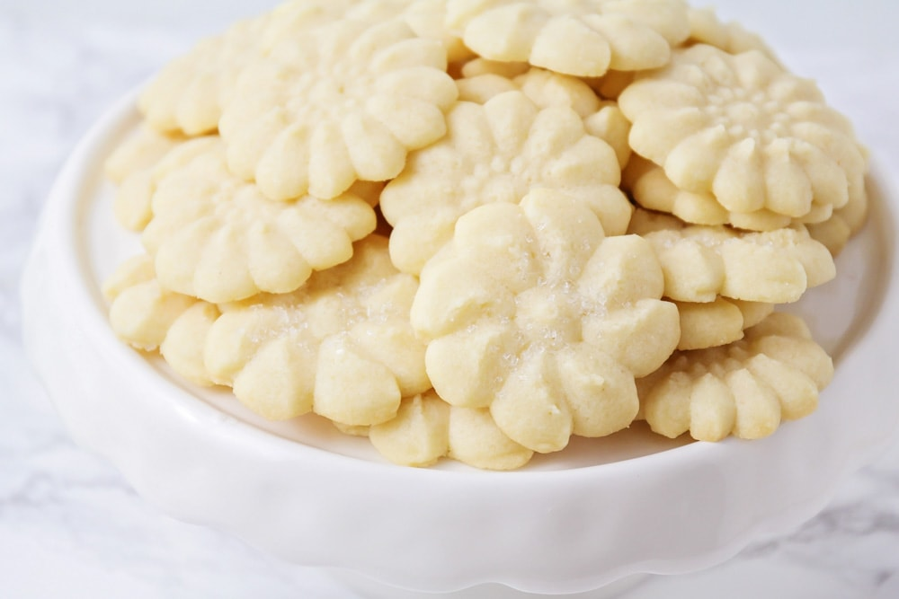 Pile of shortbread cookies on a white plate
