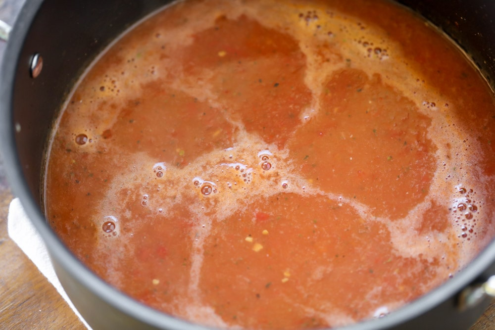 Tomato bisque cooking in pot