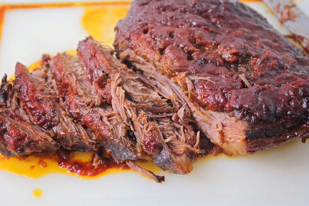Beef brisket sliced on a cutting board