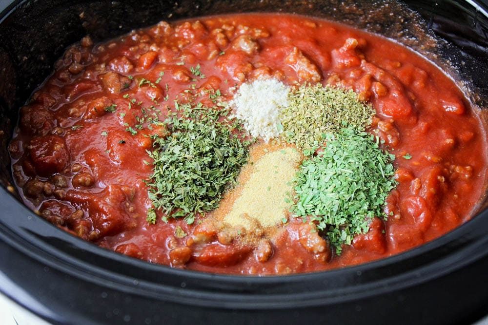 Ingredients in slow cooker for slow cooker spaghetti