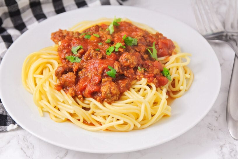 Slow cooker spaghetti on a white plate