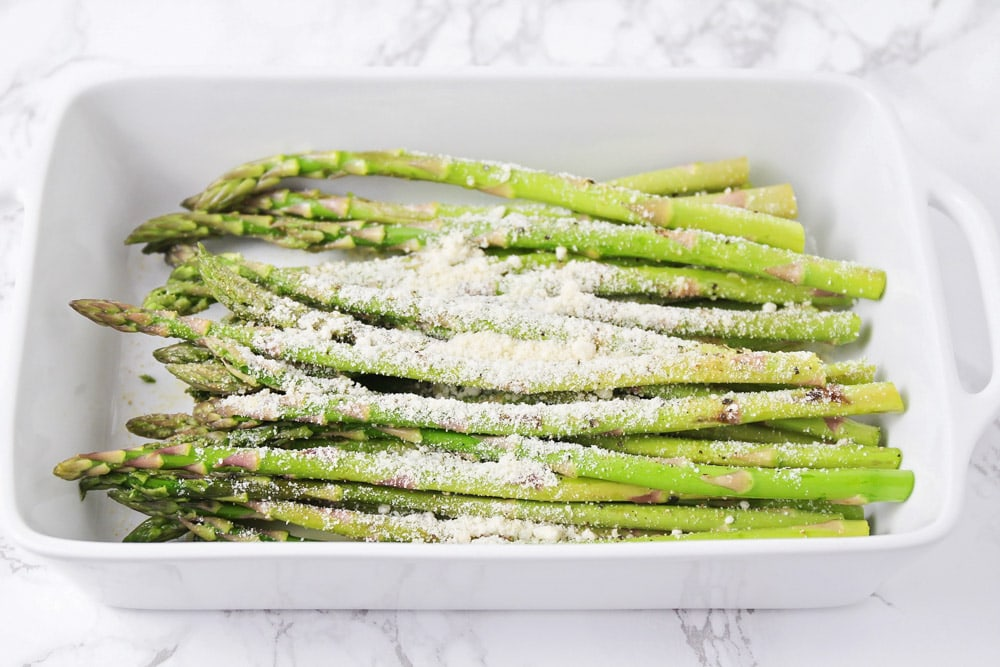 Asparagus covered in parmesan before being grilled