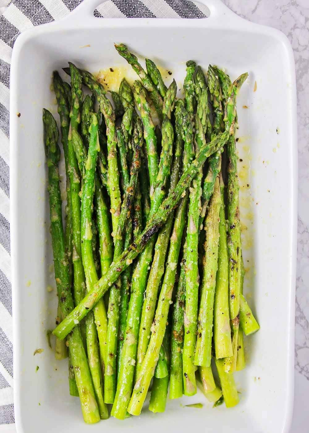 Grilled asparagus recipe in a white serving dish