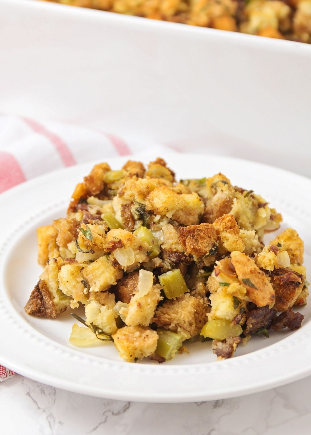 Sausage stuffing recipe on a white plate