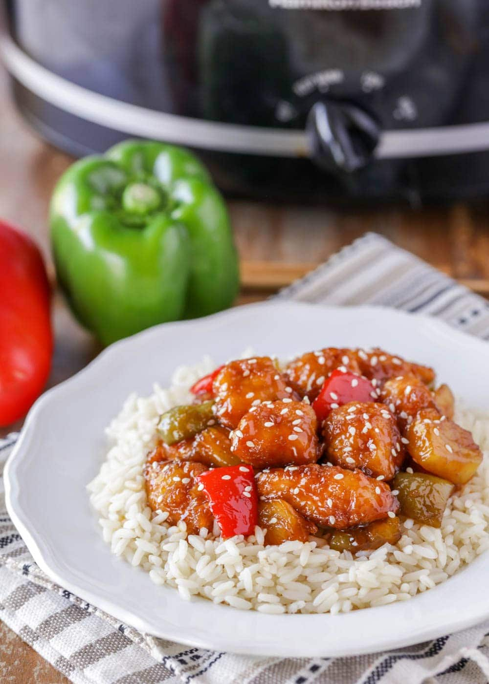 Crock pot rice served with sweet and sour chicken on top