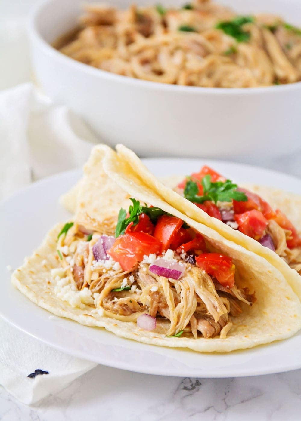Close up of pulled pork tacos with toppings