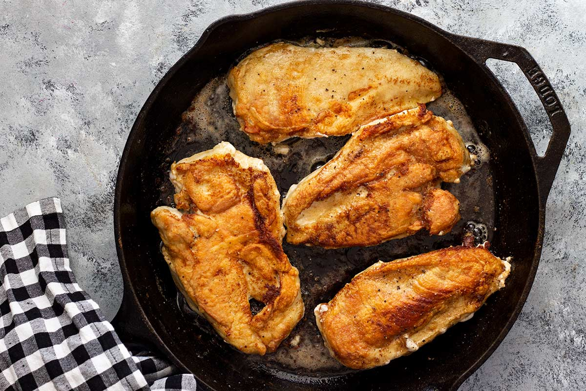 Lemon garlic butter chicken in a skillet