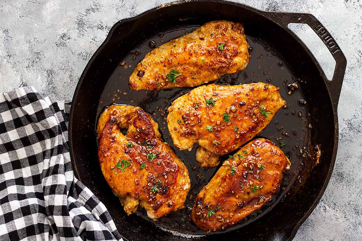 Four Lemon Garlic Chicken Breasts inside a skillet