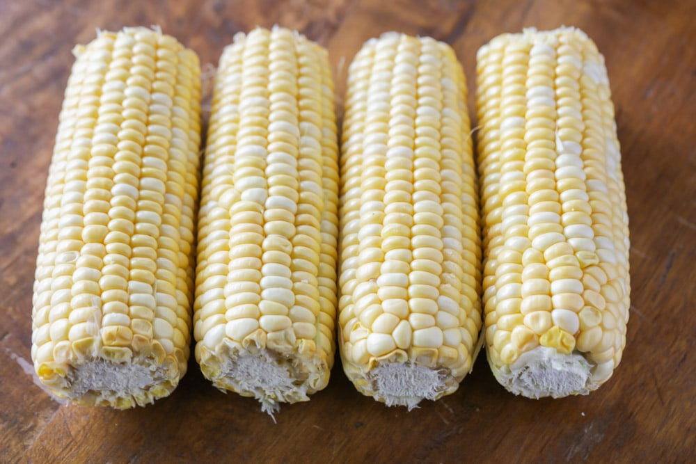 Four cobs of corn ready to be boiled
