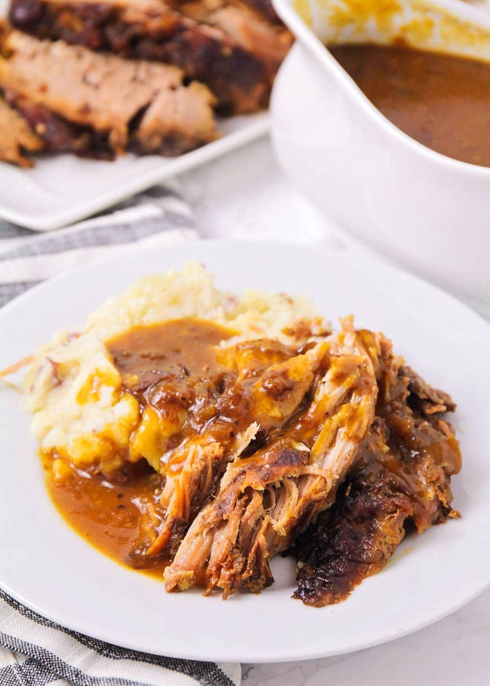 Crock pot pork roast covered in gravy