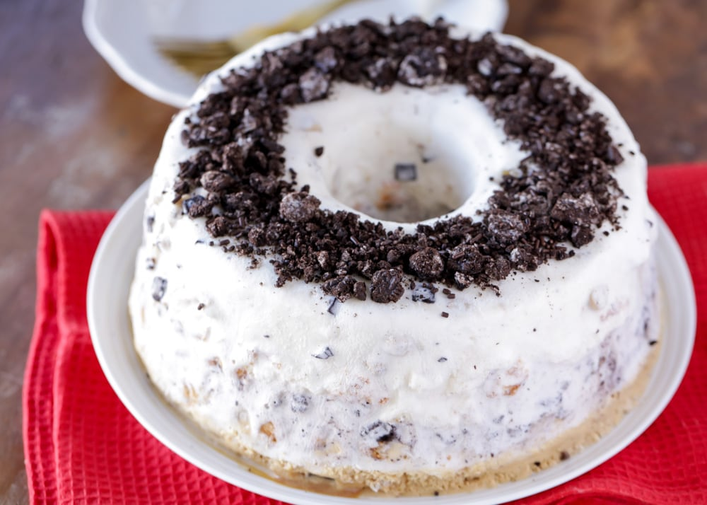 Angel food ice cream cake topped with crushed oreos