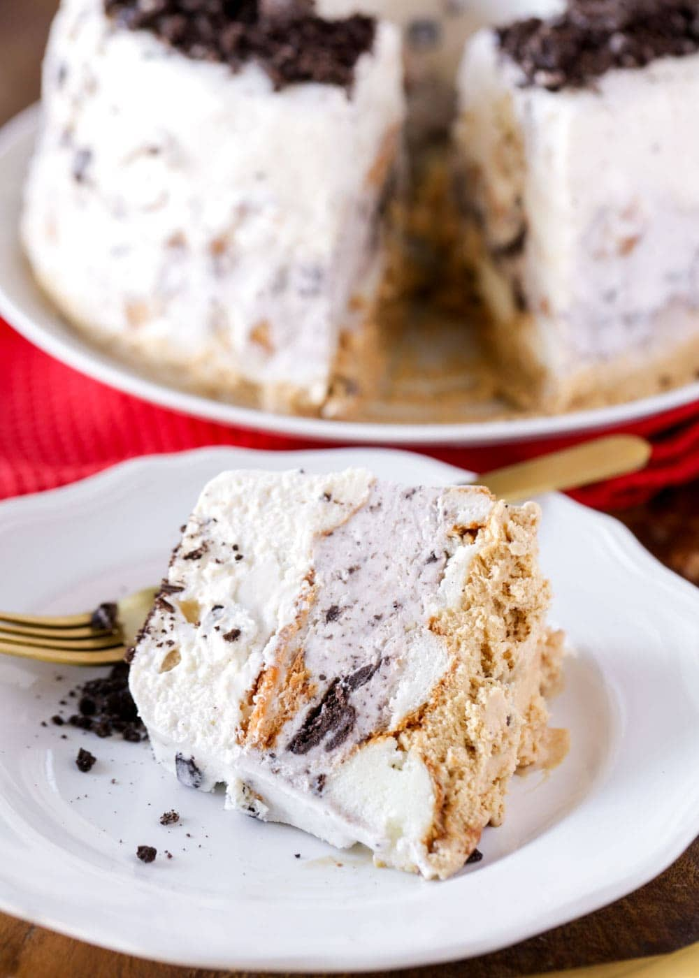 A slice of angel food ice cream cake on a white plate