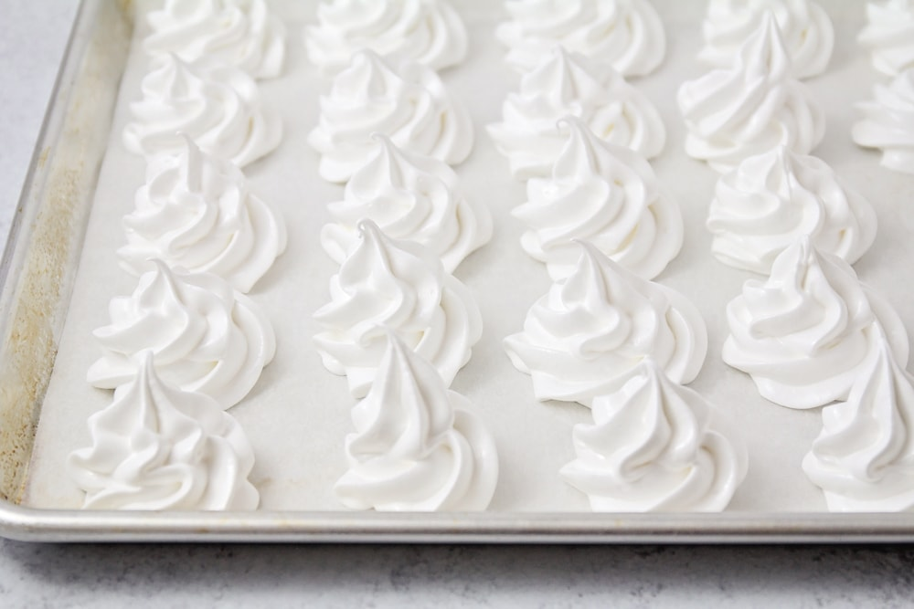 Vanilla meringue cookies on a baking sheet
