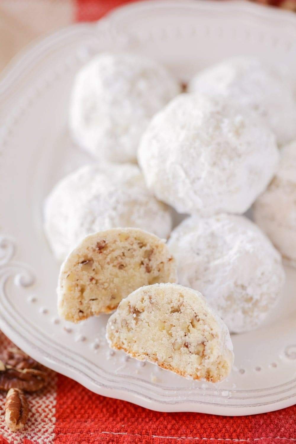 Close up of Mexican Wedding Cookies on a white plate
