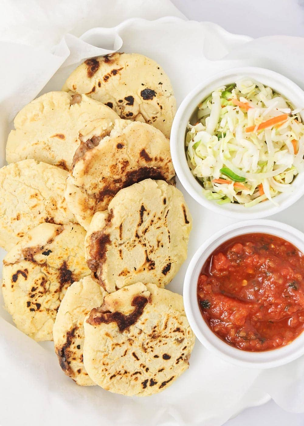 Close up of Pupusas on a white platter