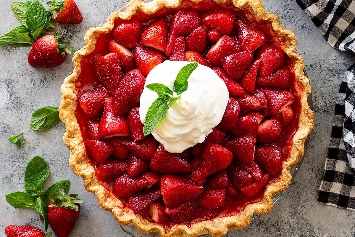 Strawberry pie with jello topped with whipped cream