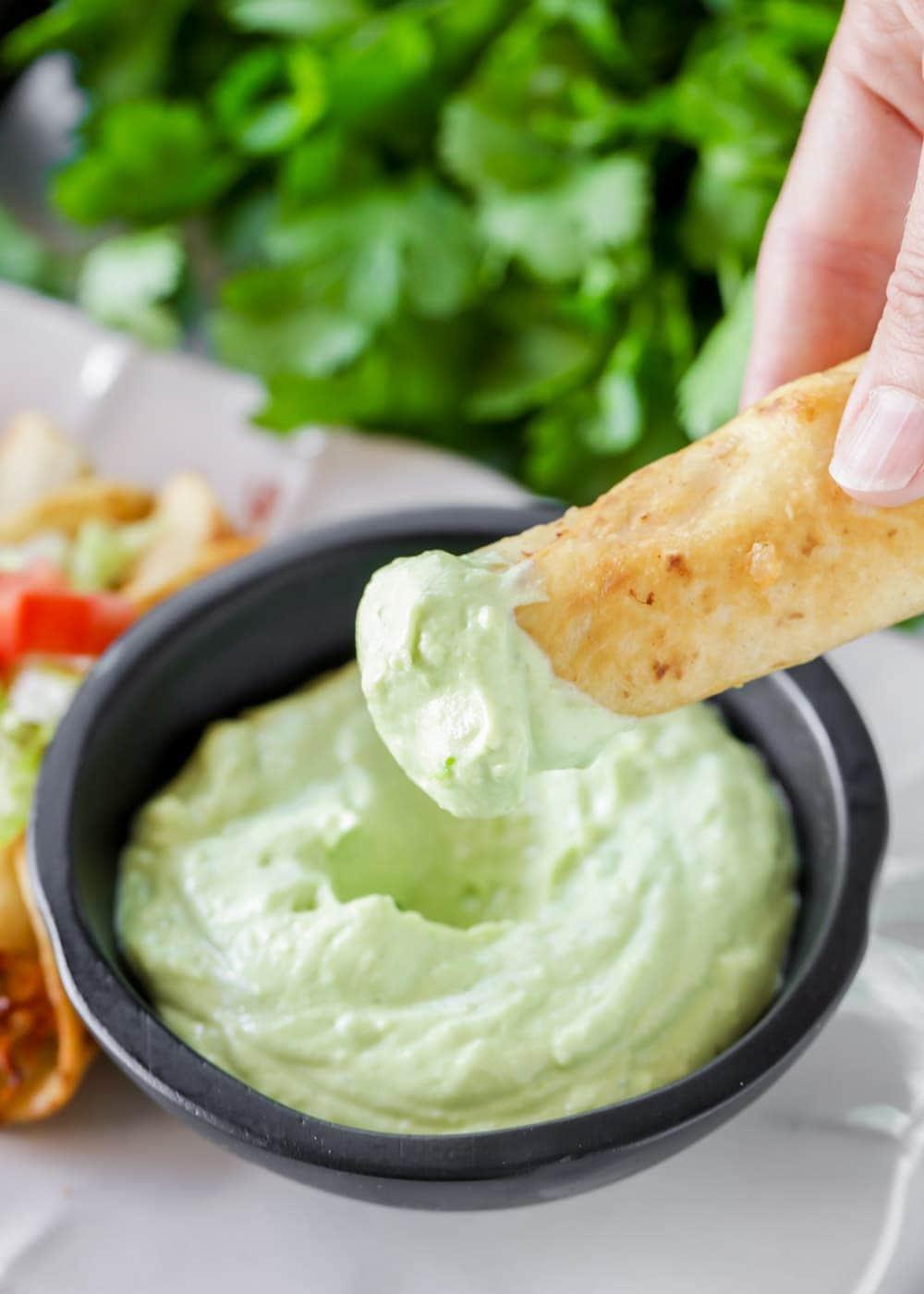 Avocado cream sauce with taquitos