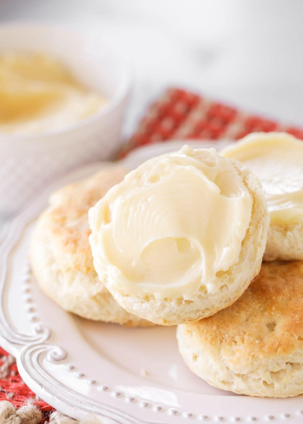 Homemade honey butter spread on biscuits