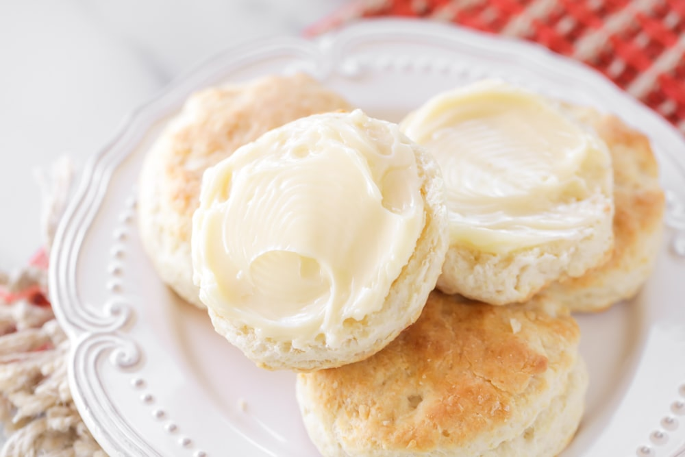 Honey butter spread on top of homemade biscuits