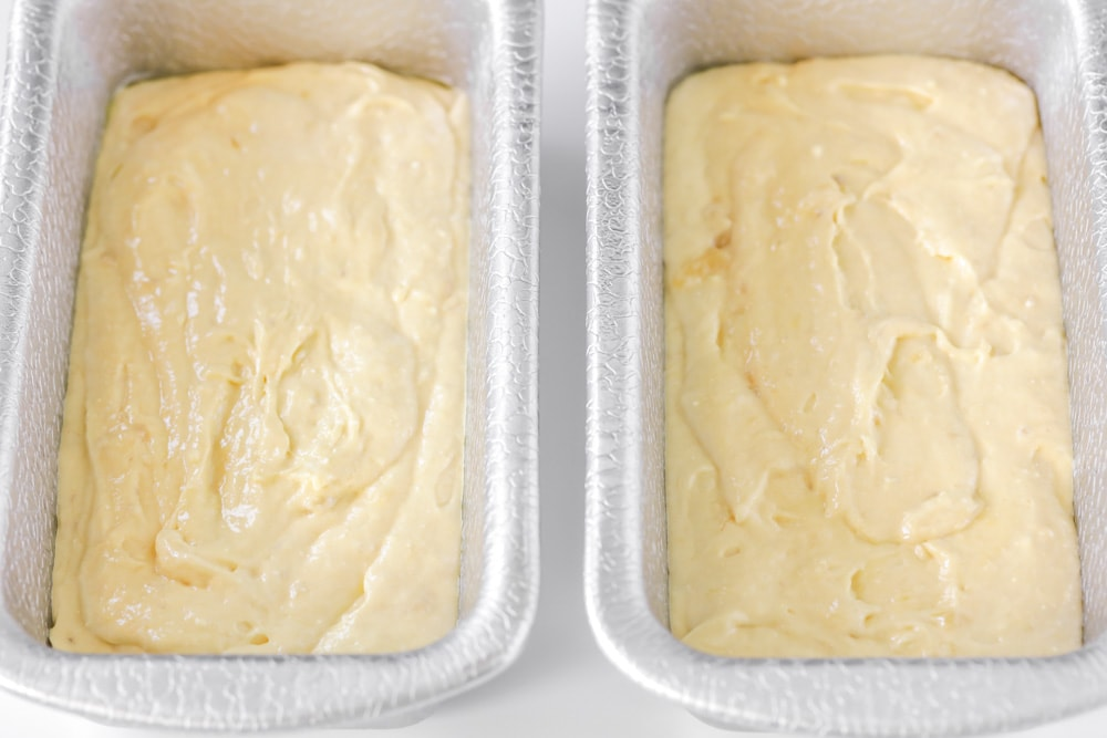 Eggnog bread batter in bread pans
