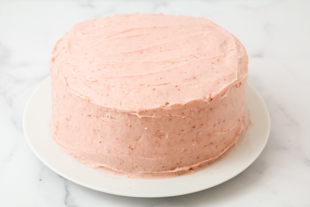 Strawberry cake with frosting on top
