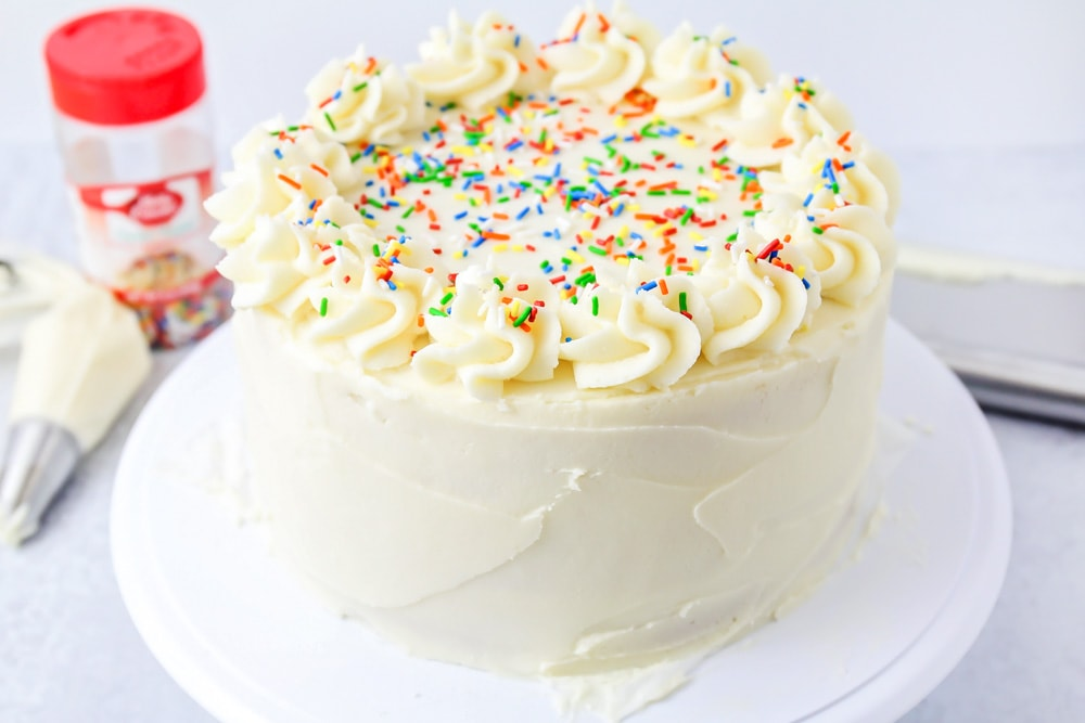 Vanilla buttercream frosting spread on top of vanilla cake