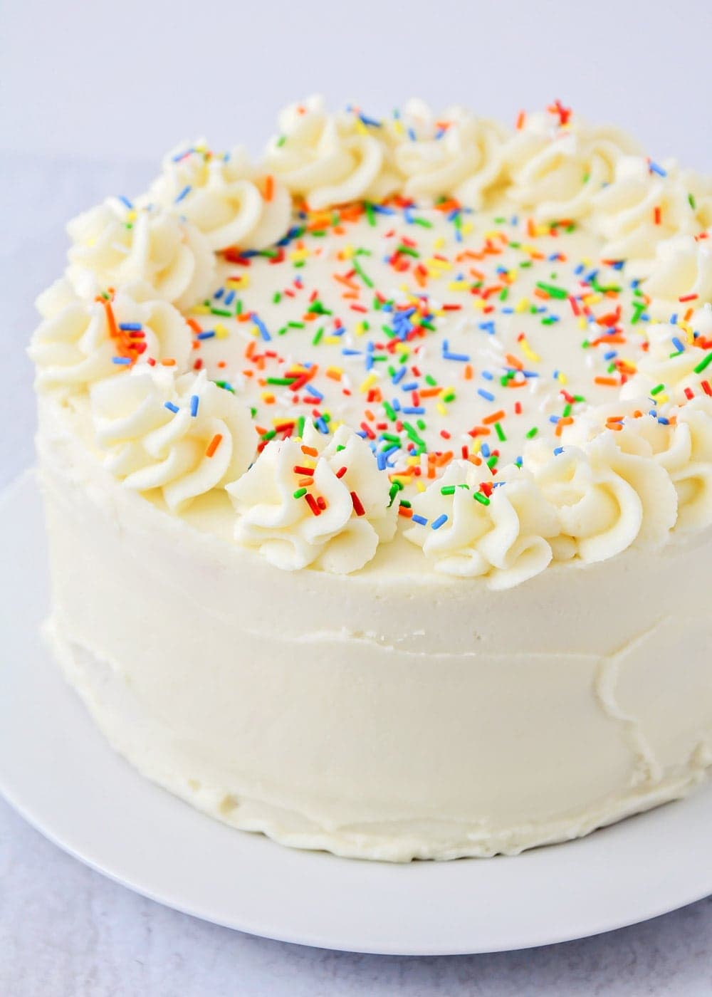 Close up of homemade vanilla frosting on a cake