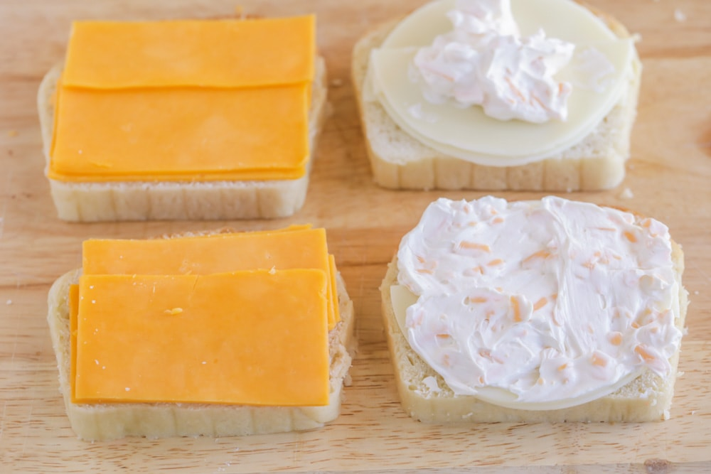 Three cheese grilled cheese with cheddar, provolone, and cream cheese spread