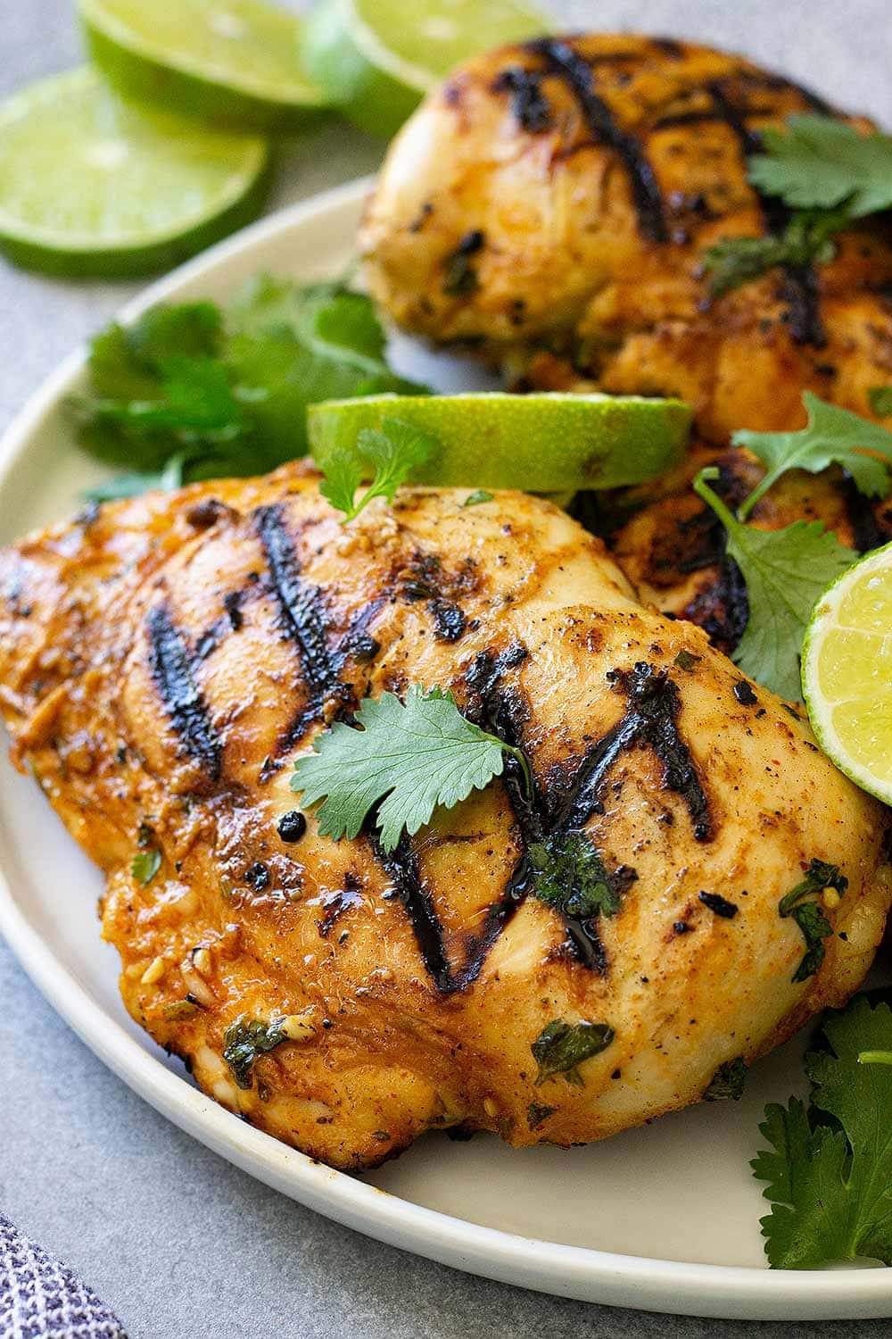 Close up of cilantro lime chicken recipe on a white plate