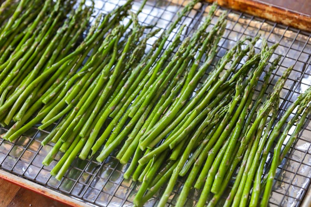 Asparagus cleaned and spread on a drying rack