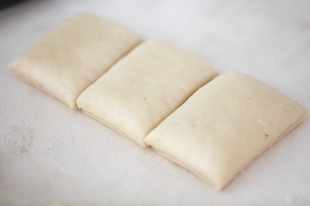 Beignet dough cut in squares