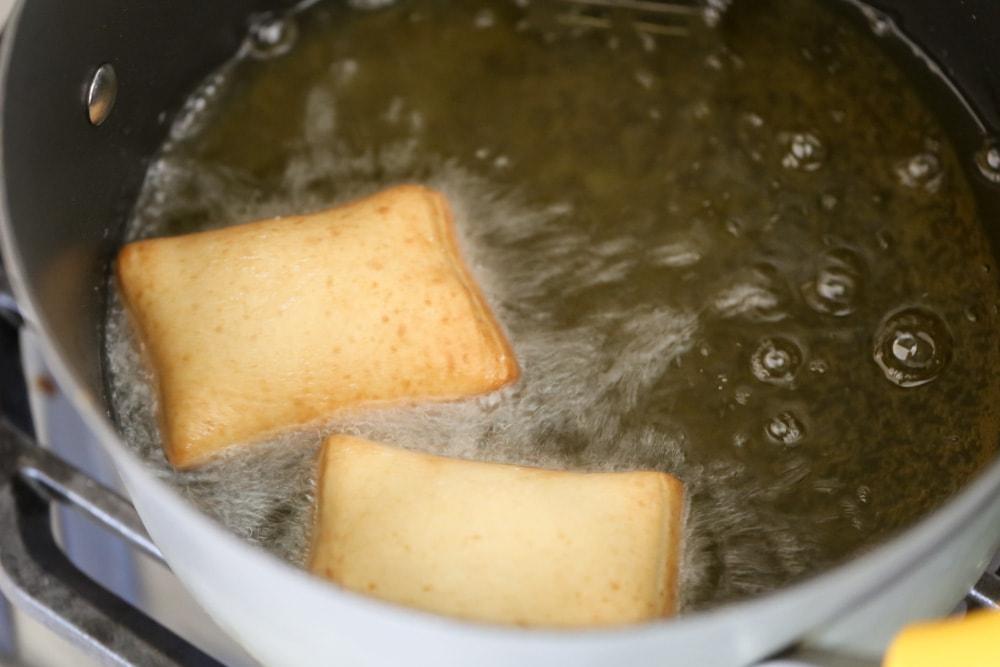 Beignets frying in oil