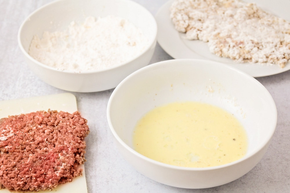 Process for coating chicken fried steak with breading