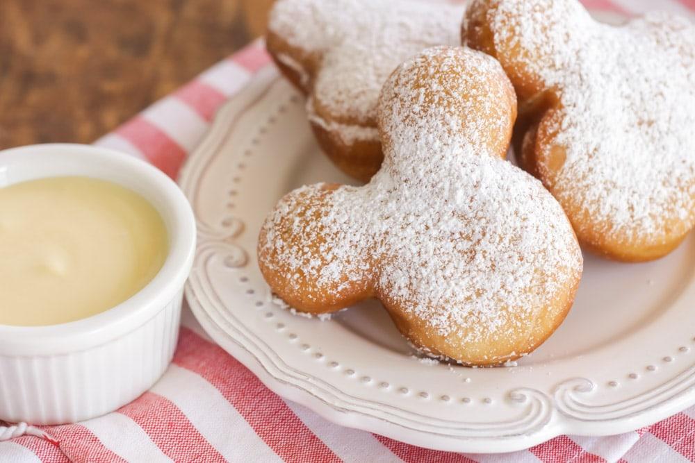 Copycat Mickey Beignets recipe with vanilla cream sauce