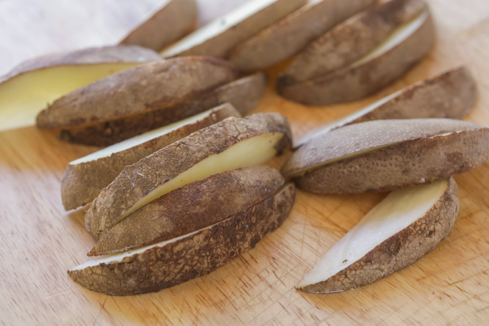 Raw potatoes sliced into wedges