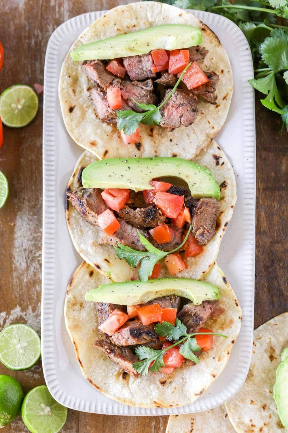 Mexican steak tacos on white platter
