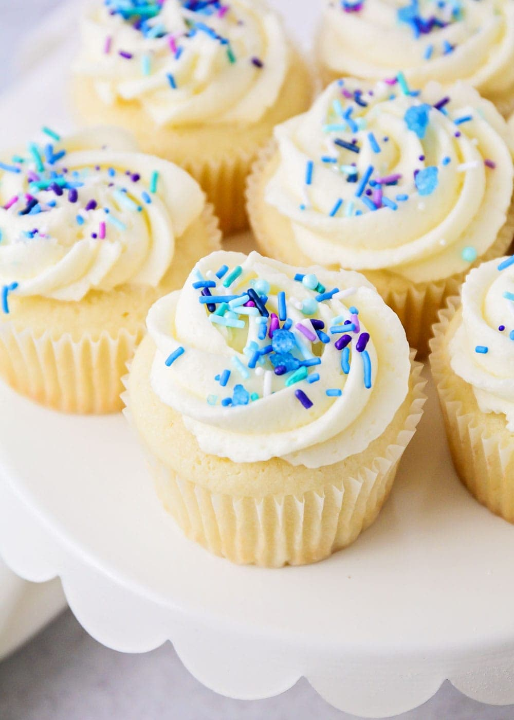 Close up of vanilla cupcakes on a cupcake stand