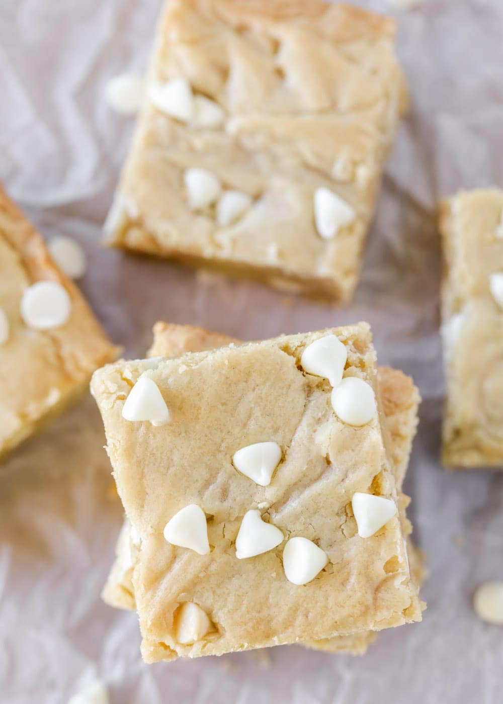Best blondie recipe stacked on parchment paper